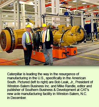 Caterpillar is leading the way in the resurgence of manufacturing in the U.S., specifically in the American South. Pictured (left to right) are Bob Leak, Jr., President of Winston-Salem Business Inc. and Mike Randle, editor and publisher of Southern Business & Development at CAT's new axle manufacturing facility in Winston-Salem, N.C. in December.