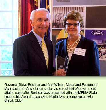Governor Steve Beshear and Ann Wilson, Motor and Equipment Manufacturers Association senior vice president of government affairs, pose after Beshear was presented with the MEMA State Leadership Award recognizing Kentucky's automotive growth. Credit: CED