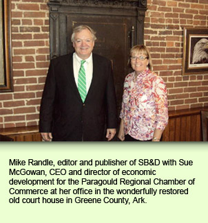 Mike Randle, editor and publisher of SB&D with Sue McGowan, CEO and director of economic development for the Paragould Regional Chamber of Commerce at her office in the wonderfully restored old court house in Greene County, Ark.