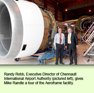 Randy Robb, Executive Director of Chennault International Airport Authority, gives Mike Randle a tour of the Aeroframe facility.