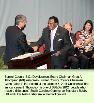 "Sumter County, S.C., Development Board Chairman Greg A. Thompson (left) welcomes Sumter County Council Chairman Gene Baten to the lectern at the October 6, 2011 Continental Tire announcement. Thompson is one of SB&D's 2012 ""people who made a difference."" South Carolina Commerce Secretary Bobby Hitt and Gov. Nikki Haley are in the background."