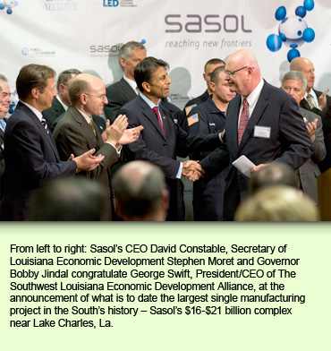 From left to right: Sasol's CEO David Constable, Secretary of Louisiana Economic Development Stephen Moret and Governor Bobby Jindal congratulate George Swift, President/CEO of The Southwest Louisiana Economic Development Alliance, at the announcement of what is to date the largest single manufacturing project in the South's history – Sasol's $16-$21 billion complex near Lake Charles, La.