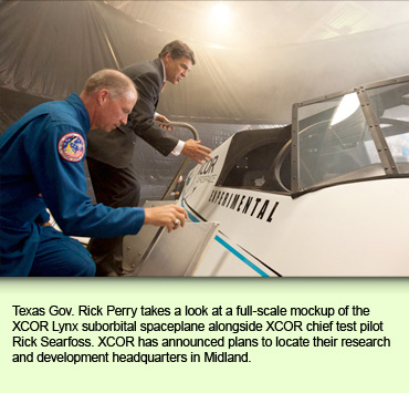 Texas Gov. Rick Perry takes a look at a full-scale mockup of the XCOR Lynx suborbital spaceplane alongside XCOR chief test pilot Rick Searfoss. XCOR has announced plans to locate their research and development headquarters in Midland.