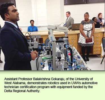 Assistant Professor Balakrishna Gokaraju, of the University of West Alabama, demonstrates robotics used in UWA's automotive technician certification program with equipment funded by the Delta Regional Authority.