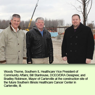 Woody Thorne, Southern IL Healthcare Vice President of Community Affairs; Bill Stanhouse, DCEO/DRA Designee; and Bradley Robinson, Mayor of Carterville at the construction site of the future Southern Illinois Healthcare Cancer Center in Carterville, Ill.