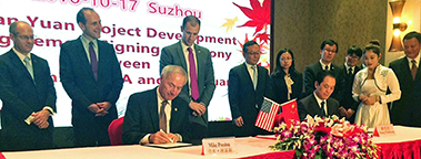 This year (2016) will mark a record year for Chinese investments in the South and the nation. Pictured is Arkansas Gov. Asa Hutchinson signing an agreement at the Tianyuan Garments announcement that the Chinese company will be hiring 400 workers in Little Rock.