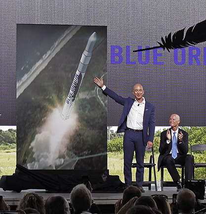 For years, Florida was where NASA launched rockets and the shuttle, but today, much of the manufacturing for the space industry is also being done in the state. Pictured is Blue Origin's Jeff Bezos and Florida Gov. Rick Scott.