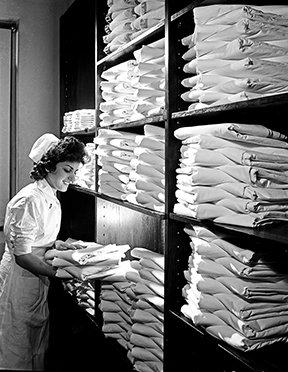 A nurse in the hospital linen closet of the Pepperell Manufacturing Company in San Antonio, Texas, was photographed by Robert Yarnall Richie in 1943.